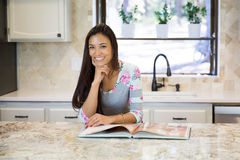 Happy Young housewife thinking of a recipe for dinner Stock Image