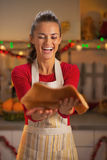 Happy young housewife throwing up dough for christmas cookies Royalty Free Stock Photo
