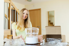 Happy young  housewife unpacking  new steamer Royalty Free Stock Photography