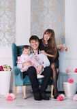 Happy young ideal smiling family at home, mother, father and daughter Royalty Free Stock Image