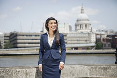 Happy young Indian businesswoman with St. Paul's Cathedral in background Stock Image