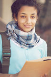 Happy young indian woman with book royalty free stock photos