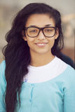 Happy young indian woman with glasses stock images