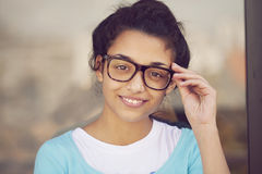 Happy young indian woman with glasses stock image