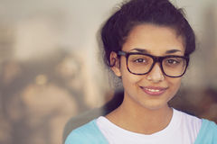 Happy young indian woman with glasses stock photo
