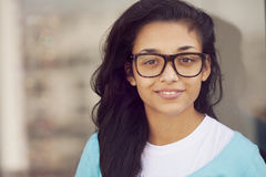 Happy young indian woman with glasses Royalty Free Stock Images