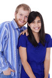 Happy young interracial couple in blue Royalty Free Stock Image