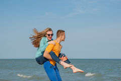 Happy young joyful guy and girl Royalty Free Stock Photo