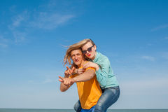 Happy young joyful guy and girl Royalty Free Stock Image
