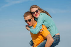 Happy young joyful guy and girl Stock Photos