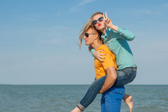 Happy young joyful guy and girl Royalty Free Stock Photos