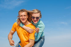 Happy young joyful guy and girl Stock Image
