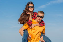 Happy young joyful guy and girl Stock Images