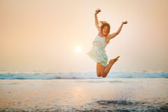 Happy young jumping girl Stock Photos