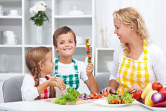 Happy young kids preparing a healthy snack Royalty Free Stock Image