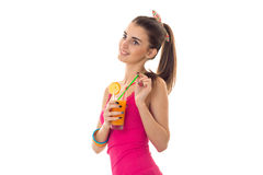 Happy young lady with dark hair in pink summer shirt drink orange cocktail and smiling isolated on white background Royalty Free Stock Photography