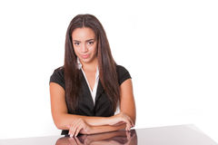 Happy young lady at desk, isolated on white Royalty Free Stock Photos