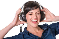 Happy young lady enjoying music in her headphones Stock Image