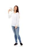 Happy young lady holding cash-polish zloty Royalty Free Stock Image