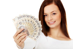 Happy young lady holding cash-polish zloty Stock Images