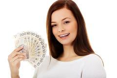 Happy young lady holding cash-polish zloty Royalty Free Stock Photo