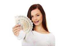 Happy young lady holding cash-polish zloty Stock Photos