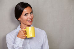 Happy young lady holding hot drink Stock Image