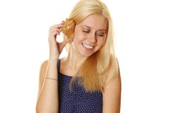 Happy young lady holding a shell Royalty Free Stock Photos