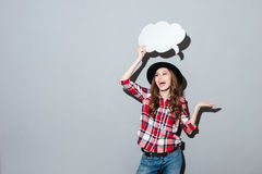 Happy young lady holding speech bubble. Stock Images