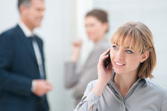 Happy young lady at phone Royalty Free Stock Photos