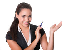 Happy young lady points with pen Stock Photo