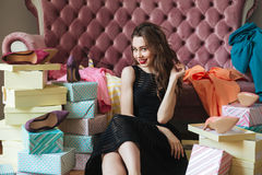 Happy young lady sitting on floor near sofa indoors Royalty Free Stock Photo