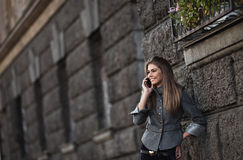 Happy young lady talking on mobile phone Royalty Free Stock Photos