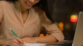 Happy young lady writing down new brilliant idea, journalist having inspiration stock video