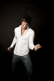 Happy young latin man dancing royalty free stock photography