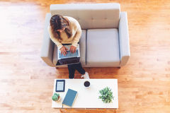 Happy young latina woman using her laptop at home Royalty Free Stock Images