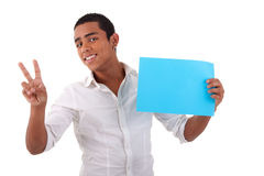 Happy young latino man, with blue card in hand Stock Photography