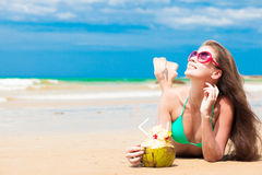 Happy young long haired woman in bikini with Stock Image