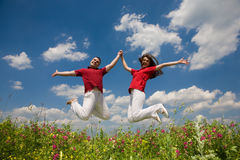 Happy Young love Couple - jumping Royalty Free Stock Images