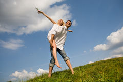 Happy Young love Couple - jumping Stock Photos