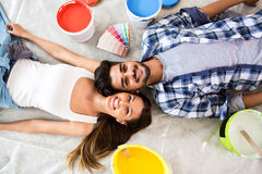 Happy young couple renovation new home. Happy young lovely couple renovation new home stock image