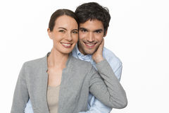 Happy  young lover couple standing on white background, isolated Stock Photography