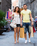 Happy young loving couple with  bags at city Stock Photo