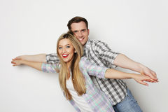 Happy young loving couple holding hands royalty free stock photography