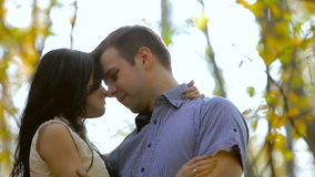 Happy young loving couple looking at each other  in autumn park stock video footage