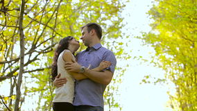 Happy young loving couple looking at each other  in autumn park stock video