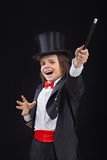 Happy young magician royalty free stock photography