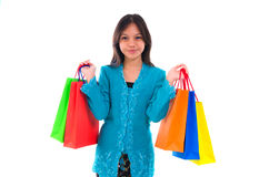 Happy young malay girl during shopping festival with white backg Royalty Free Stock Images