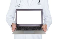 Happy young male doctor holding laptop Stock Images
