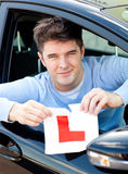 Happy young male driver tearing up his L sign Royalty Free Stock Photos